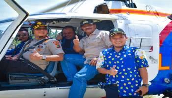 Naik Helikopter Bersama Kapolda, Gubernur Disambut Antusias Masyarakat Selat Nasik